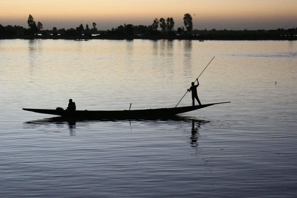 Pescadores en el río Bani