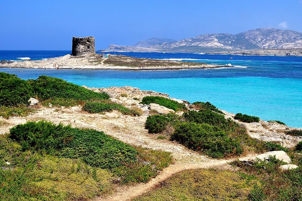 Vista de la playa de la Pelos y la torre Aragonesa