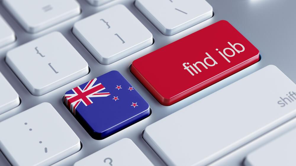 Ordenador con teclas para buscar trabajo en Nueva Zelanda