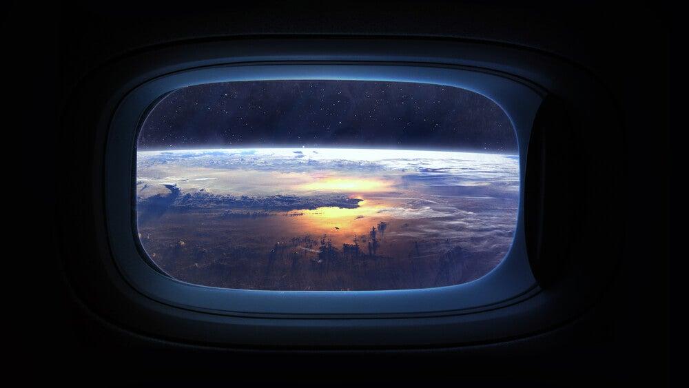 Espacio vista desde la ventana de una nave