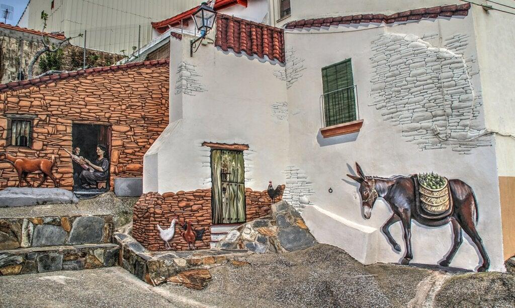 Mural en la ciudad de Romangordo que refleja la vida rural del pueblo.